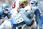 01 September 2012: UNC's Kevin Reddick (48) tackles Elon's Tracey Coppedge (22). The University of North Carolina Tar Heels played the Elon University Phoenix at Kenan Memorial Stadium in Chapel Hill, North Carolina in a 2012 NCAA Division I Football game. UNC won the game 62-0.
