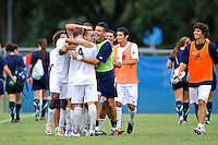 2 October 2011:  FIU's team hugs Roberto De Sousa (20, center) to celebrate his goal as the FIU Golden Panthers defeated the University of Kentucky Wildcats, 1-0 in overtime, at University Park Stadium in Miami, Florida.