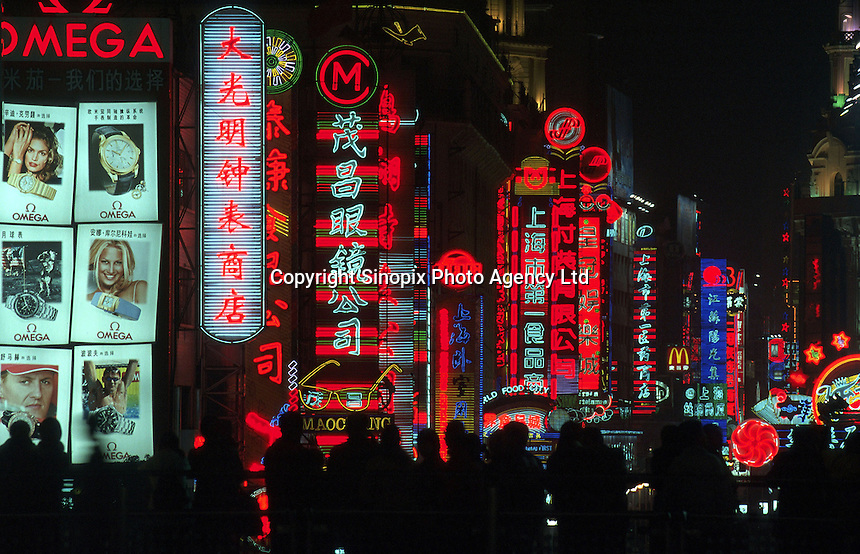 The glittering neon of Shanghai's Nanjing Road, one of the city's main shopping centres..\