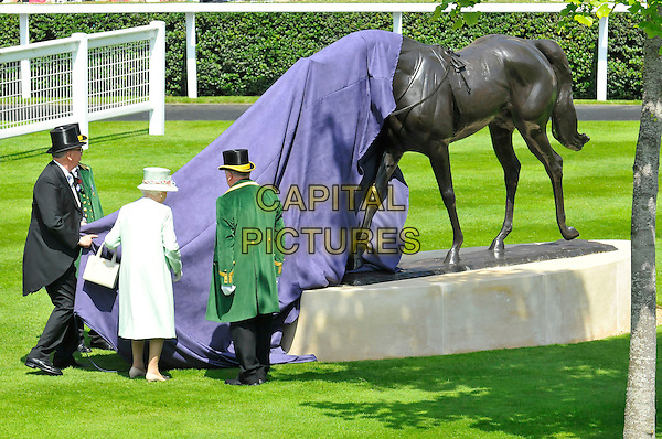 HRH Queen Elizabeth II .At Day One of Royal Ascot, Ascot Racecourse, Ascot, Berkshire, England, UK, June 14th, 2011..full length pale green coat dress hat  gloves cream bag white handbag back rear behind unveiling statue horse .CAP/CAS.©Bob Cass/Capital Pictures.