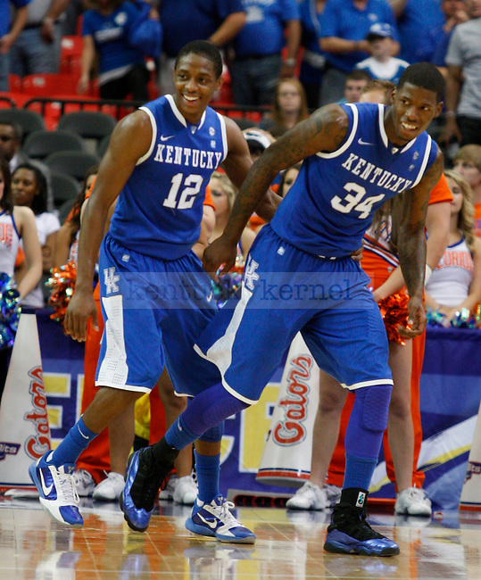 Brandon Knight and DeAndre Liggins smile in the final moments of the championship of the 2011 SEC Men's Basketball Tournament, at the Georgia Dome, Sunday, March 13, 2011.  Kentucky beat Florida 70-54.  Photo by Latara Appleby | Staff