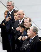 Former U.S. President George W. Bush, right, his wife Laura Bush, second from right, and brother Jeb Bush, second from left, watch as a U.S. military honor guard carries the flag-draped casket of former President George H.W. Bush from the U.S. Capitol Wednesday, Dec. 5, 2018, in Washington. <br /> Credit: Win McNamee / Pool via CNP