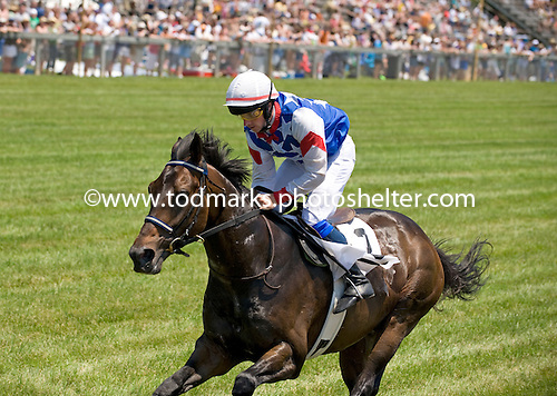 Objective and jockey Paul Madden win the opener at Fair Hill.