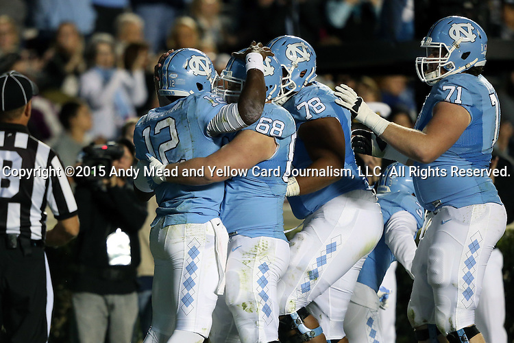 17 October 2015: UNC's Marquise Williams (12) celebrates his touchdown with Patrick Osterhage (68), Tyler Hayworth (78), and Nathan Gilliam (71). The University of North Carolina Tar Heels hosted the Wake Foresst University Demon Deacons at Kenan Memorial Stadium in Chapel Hill, North Carolina in a 2015 NCAA Division I College Football game. UNC won the game 50-14.