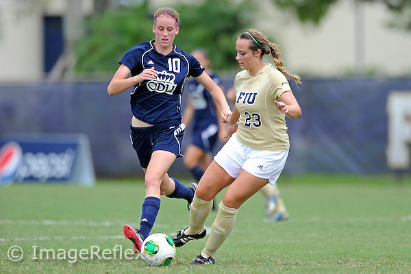 29 September 2013:  FIU defender Shelby Bowden (23) passes the ball as ODU midfielder Jessie Klamut (10) looks on in the first half as the FIU Golden Panthers defeated the Old Dominion University Monarchs, 4-0, at University Park Stadium in Miami, Florida.