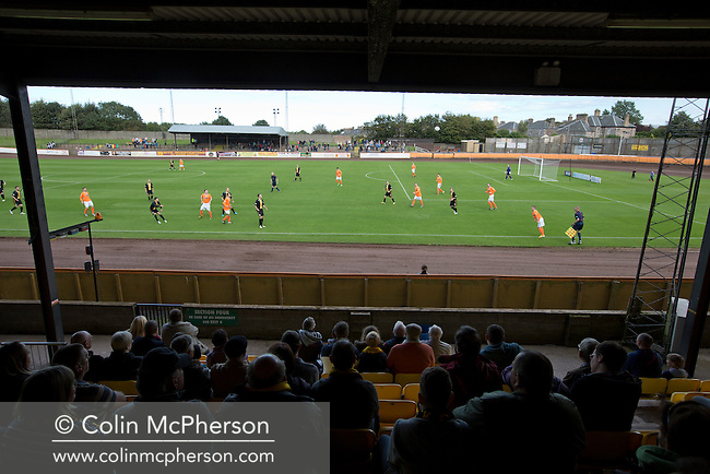 Action from the first half at Shielfield Park, during the Scottish League Two fixture between Berwick Rangers and East Stirlingshire (orange shirts). The home club occupied a unique position in Scottish football as they are based in Berwick-upon-Tweed, which lies a few miles inside England. Berwick won the match by 5-0, watched by a crowd of 509.