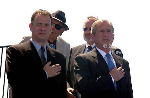Washington, D.C. - May 29, 2004 -- Actor Tom Hanks, left and United States President George W. Bush, right, at the dedication of the World War Two Memorial in Washington, D.C. on May 29, 2004..Credit: Ron Sachs / CNP