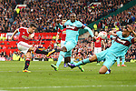 West Ham?s Winston Reid appears to block a shot from Ander Herrera of Manchester United with his arm leading to calls for handball during the Emirates FA Cup match at Old Trafford. Photo credit should read: Philip Oldham/Sportimage