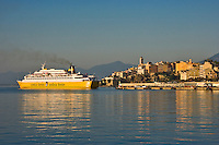 Corsica. Bastia. Citadel and Quartier Terra Nova and entrance to the Old Port. Car ferry arriving.  France.