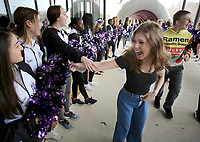 NWA Democrat-Gazette/DAVID GOTTSCHALK Mia Kieklak, an eighth grade student at Woodland Junior High School, is greeted by members of the Fayetteville High School Dance Team Tuesday, February 5, 2019, as she and the eighth grade class arrive at the high school for the Bulldog Bash. Students from Woodland High School were greeted by the high school band and spirit squads before participating in an orientation and tour of the campus.