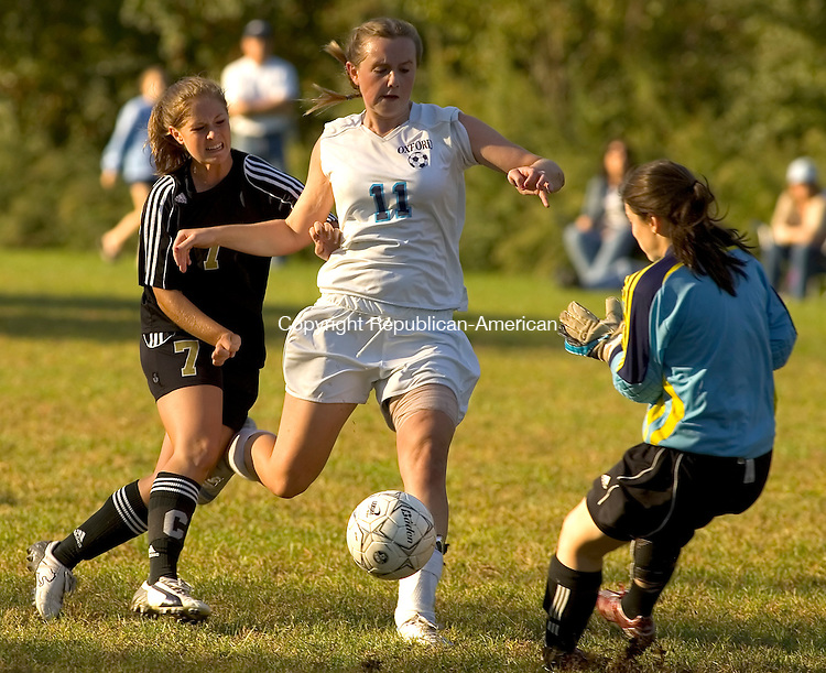 OXFORD, CT- 23 SEPTEMBER 2008 --092308JS03--Oxford's Kelsey Svenson (11) has her shot blocked by Joel Barlow's goalie Kara Davis after getting past defender Danielle Winstanley (7) during their game Tuesday at Oxford Glen. <br /> Jim Shannon / Republican-American