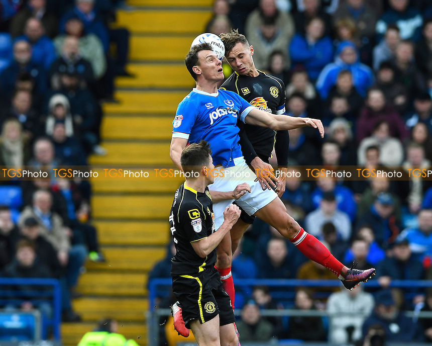 Kal Naismith of Portsmouth and George Ray of Crewe Alexandra vie for a header during Portsmouth vs Crewe Alexandra, Sky Bet EFL League 2 Football at Fratton Park on 4th March 2017