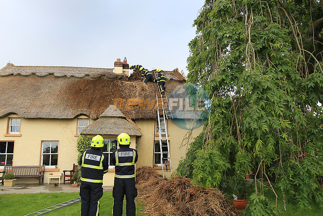 Three units from Drogheda fire service, backed up by Dunleer fire service attended the scene of a roof fire in a tatch house in cartown, outside Drogheda on Saturday evening..Picture: Fran Caffrey / www.newsfile.ie