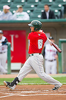 Maxx Tissenbaum (8) of the Fort Wayne TinCaps follows through on his swing against the Lansing Lugnuts at Cooley Law School Stadium on June 5, 2013 in Lansing, Michigan.  The TinCaps defeated the Lugnuts 8-5.  (Brian Westerholt/Four Seam Images)