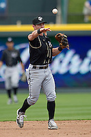 Omaha Storm Chasers second baseman Johnny Giavotella #9 makes a throw to first base against the Round Rock Express in the Pacific Coast League baseball game on April 7, 2013 at the Dell Diamond in Round Rock, Texas. Omaha beat Round Rock 5-2, handing the Express their first loss of the season. (Andrew Woolley/Four Seam Images).