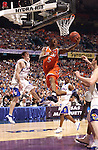 7 April 2003: Syracuse guard Josh Pace (5) goes airborne past Kansas guard Kirk Hinrich (10) during the Men's Division I Final Four Championships held at the Louisiana Superdome in New Orleans, LA. Syracuse University went on to defeat Kansas University 81-78 for the championship title. Photo by: Ryan McKee/NCAA Photos