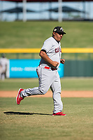 Glendale Desert Dogs pitching coach Rigo Beltran (47), of the Cleveland Indians organization, jogs off the field after visiting the pitcher's mound during an Arizona Fall League game against the Mesa Solar Sox at Sloan Park on October 27, 2018 in Mesa, Arizona. Glendale defeated Mesa 7-6. (Zachary Lucy/Four Seam Images)