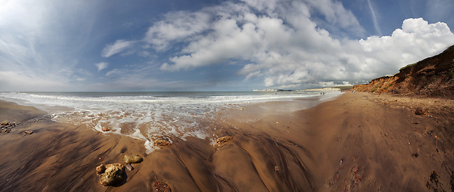 A wide-angle panoramic view of the beach at Compton Bay looking towards Freshwater.  Shot from a low point of view the image embraces the wide-angle distortion rather than attempting to correct it and attempt photo-realism.<br />
