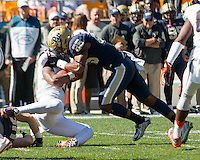 Pitt defensive back Pat Amara Jr. (25) tackles Virginia wide receiver TJ Thorpe (8). The Pitt Panthers football team defeated the Virginia Cavaliers 26-19 on Saturday October 10, 2015 at Heinz Field, Pittsburgh, Pennsylvania.