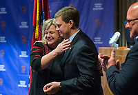 NWA Democrat-Gazette/BEN GOFF @NWABENGOFF<br /> Amy Harrison hugs Nathan Smith, Benton County prosecuting attorney, as Hayes Minor, Rogers chief of police looks on Thursday, Feb. 7, 2019, during a press conference at the Rogers Police Department. The conference was held following Grant Hardin pleading guilty to raping Harrison, at the time a teacher at Frank Tillery Elementary, in 1997.