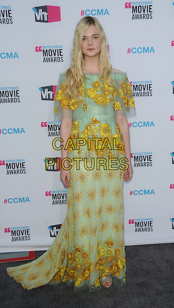 Elle Fanning.17th Annual Critics Choice Movie Awards held at the Hollywood Palladium, Los Angeles, California, USA..January 12th, 2012.full length off the shoulders maxi yellow green print sunflowers sunflower sheer dress floral .CAP/ROT/TM.©Tony Michaels/Roth Stock/Capital Pictures