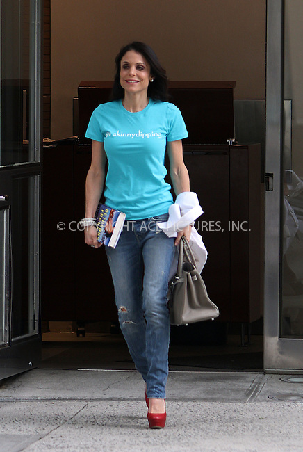 WWW.ACEPIXS.COM . . . . .  ....May 3 2012, New York City....TV personalty Bethenny Frankel leaves her Tribeca apartment wearing a 'go skinnydipping' tee shirt and carrying a copy of her book 'Skinnydipping' on May 3 2012 in New York City....Please byline: Zelig Shaul - ACE PICTURES.... *** ***..Ace Pictures, Inc:  ..Philip Vaughan (212) 243-8787 or (646) 769 0430..e-mail: info@acepixs.com..web: http://www.acepixs.com