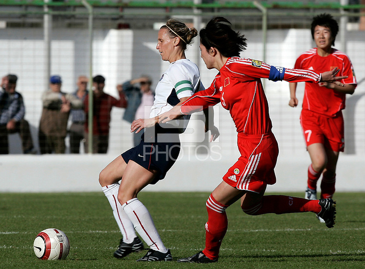 Kristine Lilly shields the ball during a Algarve Women´s Cup soccer match between USA and China at the Silves Stadium in Silves, Portugal, March 7, 2007.