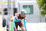 An amateur cyclist tries to cross the finish line with Oliver Naesen (BEL) AG2R La Mondiale who sees the funny side of the prank at the end of Stage 2 of the Criterium du Dauphine 2019, running 180km from Mauriac to Craponne-sur-Arzon, France. 9th June 2019<br /> Picture: Colin Flockton | Cyclefile<br /> All photos usage must carry mandatory copyright credit (© Cyclefile | Colin Flockton)