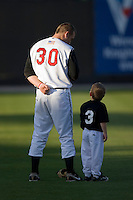 Todd Frazier #30 of the Carolina Mudcats with a young fan during the National Anthem at Five County Stadium May 19, 2009 in Zebulon, North Carolina. (Photo by Brian Westerholt / Four Seam Images)