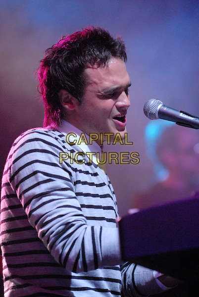 GARETH GATES.Plays live on Day One of the Hyde Park Calling Music Festival in Hyde Park, London, June 23rd 2007. .half length grey and blue striped top microphone sitting profile singing gig concert live on stage.CAP/IA.©Ian Allis/Capital Pictures