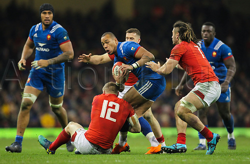 17th March 2018, Principality Stadium, Cardiff, Wales; NatWest Six Nations rugby, Wales versus France; Gael Fickou of France is tackled by Hadleigh Parkes of Wales
