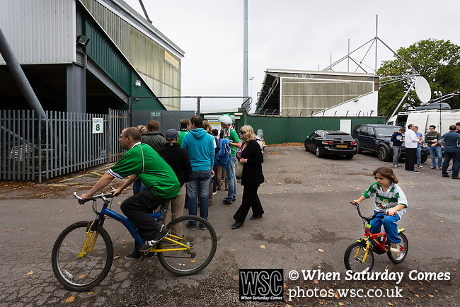 Yeovil Town 0 Queens Park Rangers 1, 21/09/2013. Huish Park, Championship. Man and young girl cycling to the game. Photo by Paul Thompson.