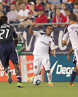 Los Angeles Galaxy forward Miguel Lopez (25) dribbles at midfield. In a Major League Soccer (MLS) match, the Los Angeles Galaxy defeated the New England Revolution, 1-0, at Gillette Stadium on May 28, 2011.