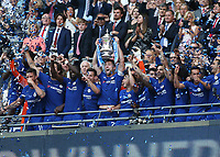19th May 2018, Wembley Stadium, London, England; FA Cup Final football, Chelsea versus Manchester United; Gary Cahill of Chelsea lifts the FA Cup with his players on the gantry