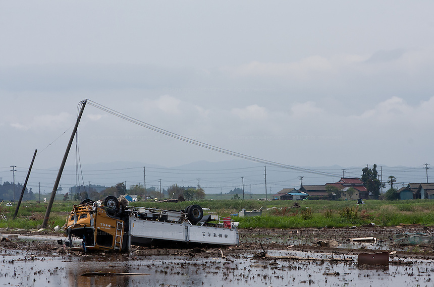 An upturned truck in a rice field after the tsunami in the coastal towns near Iwanuma, Sendai, Miyagi, Japan Sunday July 3rd 2011