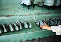 Workers labor on the production line for women's shoes at the Junsheng Shoe Factory in Dongguan, China..12 Nov 2008