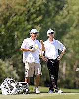 03 AUG 13 Caddie Patrick Turley talks it over in the 18th fairway with Chris Riley during Saturdays Third Round at The Reno Tahoe Open at The Montreux Country Club in Reno, Nevada.  (photo:  kenneth e.dennis / kendennisphoto.com)