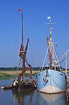 AT5BR5 Sailing barge and boat moored quayside Snape maltings Suffolk England
