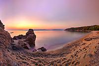 The sunset at the beach Agia Eleni of Skiathos island, Greece