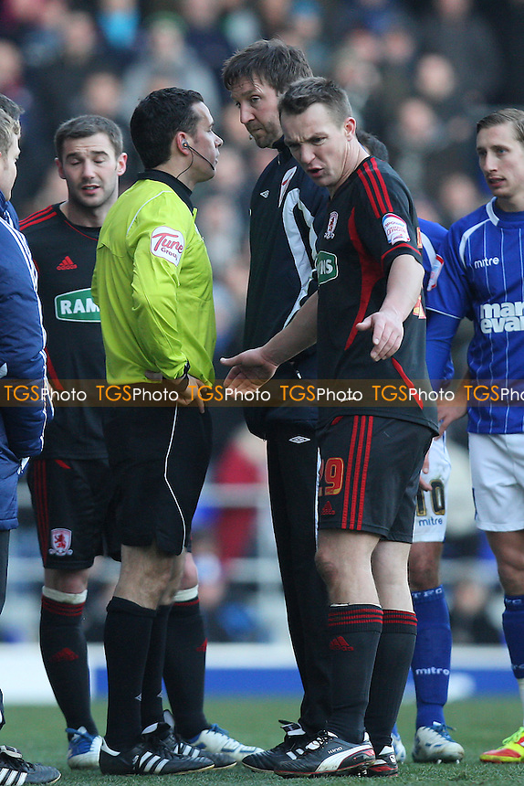 Referee Dean Whitestone (2nd L) in discussion with the fourth official and Tony McMahon of Middlesborough prior to abandoning the match - Ipswich Town vs Middlesborough - nPower Championship Football at Portman Road, Ipswich, Suffolk - 11/02/12 - MANDATORY CREDIT: Gavin Ellis/TGSPHOTO - Self billing applies where appropriate - 0845 094 6026 - contact@tgsphoto.co.uk - NO UNPAID USE.