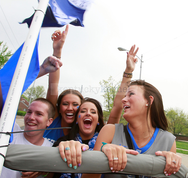 Freshmen Madison Latter, Taylor Watson, Morgan Yetter, and Christine Oyler ride in the back of a Jeep down Avenue of Champions before the UK-Louisville Final Four game on March 31, 2012. Photo by Alex Lovan | StaffFans prepare for the UK-Louisville Final Four game on March 31, 2012, in Lexington, Ky. Photo by Alex Lovan | Staff