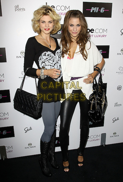 ANGEL McCORD & RACHEL McCORD.Mi-6 Night Club Grand Opening Party held At Mi-6 Night club, West Hollywood, California, USA..September 15th, 2009.full length sisters family jeans denim white black top bag purse leather leggings.CAP/ADM/KB.©Kevan Brooks/AdMedia/Capital Pictures.