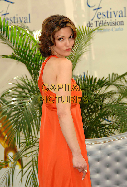 "ALANA DE LA GARZA.Photocall promoting the television series ""Law And Order"" during the fourth day of the 2008 Monte Carlo Television Festival held at Grimaldi Forum, Monaco, Principality of Monaco,.June 11th, 2008..half length red orange dress halterneck back over shoulder.CAP/TTL .©TTL/Capital Pictures"