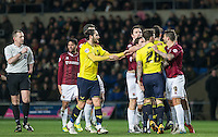 Players sound Chris Maguire of Oxford United after a foul during the Sky Bet League 2 match between Oxford United and Northampton Town at the Kassam Stadium, Oxford, England on 16 February 2016. Photo by Andy Rowland.