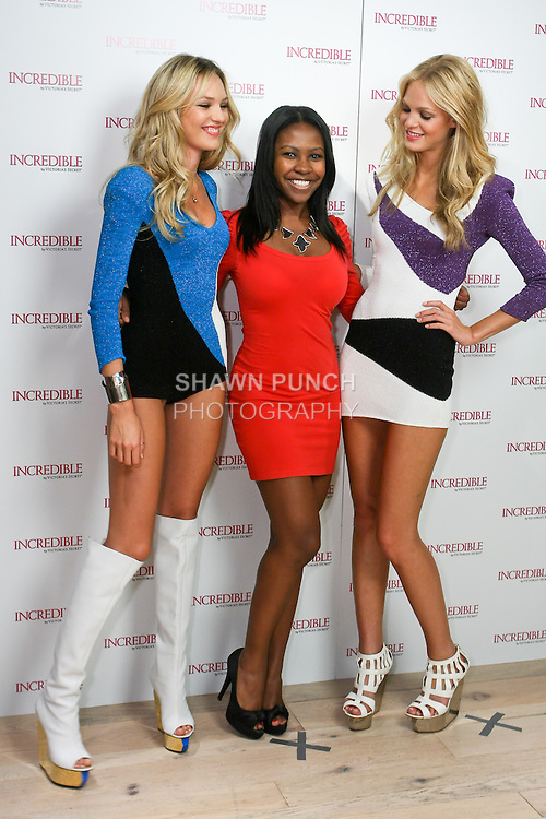 "Candice Swanepoel and Erin Heatherton poses with guest during the ""Incredible by Victoria's Secret"" launch at the Victoria Secret SOHO Store, August 10, 2010."