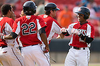 Dave Sappelt #6 of the Carolina Mudcats (right) is congratulated by teammates after his game winning hit in the bottom of the 9th against the Jacksonville Suns at Five County Stadium May 16, 2010, in Zebulon, North Carolina.  Photo by Brian Westerholt /  Seam Images