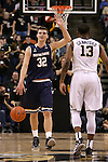 24 February 2016: Notre Dame's Steve Vasturia (32) and Wake Forest's Bryant Crawford (13). The Wake Forest University Demon Deacons hosted the University of Notre Dame Fighting Irish at Lawrence Joel Veterans Memorial Coliseum in Winston-Salem, North Carolina in a 2015-16 NCAA Division I Men's Basketball game. Notre Dame won the game 69-58.