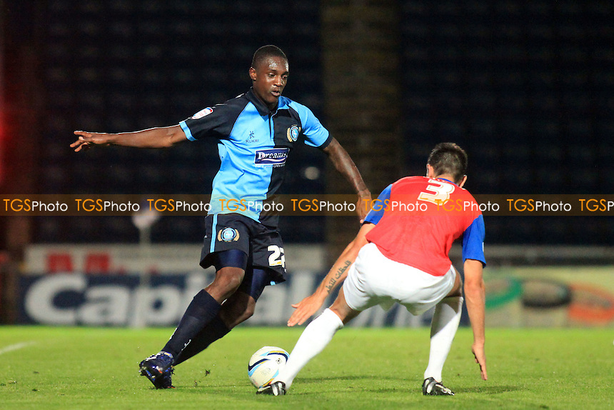 Wycombe's Anthony Stewart  takes on Joe Martin of Gillingham - Wycombe Wanderers vs Gillingham - NPower League Two Football at Adams Park, High Wycombe, Buckinghamshire - 21/08/12 - MANDATORY CREDIT: Paul Dennis/TGSPHOTO - Self billing applies where appropriate - 0845 094 6026 - contact@tgsphoto.co.uk - NO UNPAID USE.