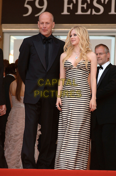 "BRUCE WILLIS & AVRIL LAVIGNE.""Over the Hedge"" screening arrivals.59th International Cannes Film Festival, France.21st May 2006.Ref: PL.full length black white striped stripes strapless suit  .www.capitalpictures.com.sales@capitalpictures.com.©Phil Loftus/Capital Pictures"
