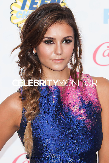 LOS ANGELES, CA, USA - AUGUST 10: Nina Dobrev arrives at the Teen Choice Awards 2014 held at The Shrine Auditorium on August 10, 2014 in Los Angeles, California, United States. (Photo by Celebrity Monitor)